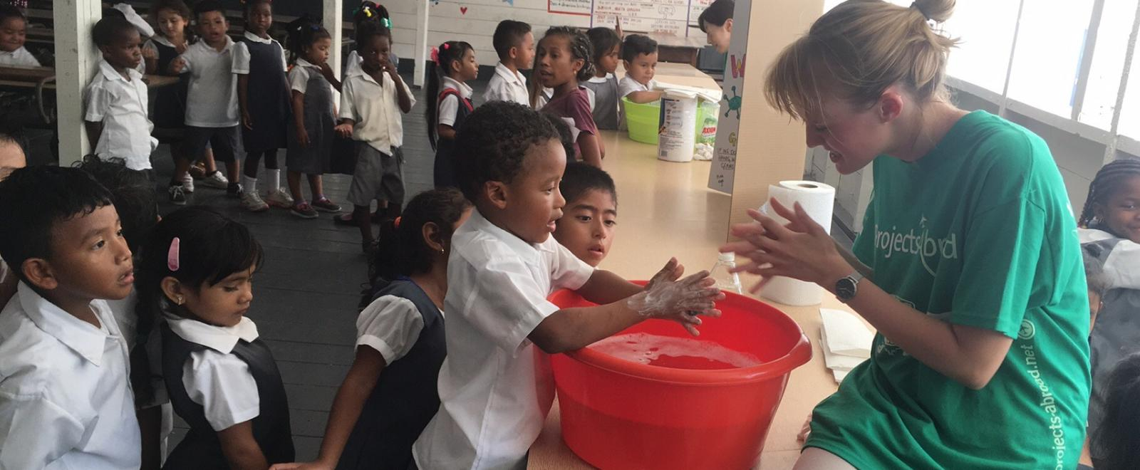 Projects Abroad volunteers practice good hygiene with children on the Public Health Internship in Belize
